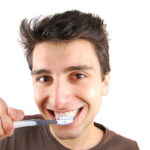 young-man-brushing-teeth